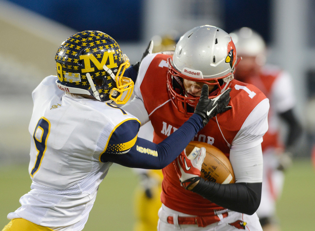 Description of . Maribeth Joeright/MJoeright@News-Herald.com <p> Mentor's Brandon Fritts is tackled by Archbishop Moeller Ian Chennell during the third quarter of the Division I state final game against Archbiship Moeller, Saturday, in Canton.
