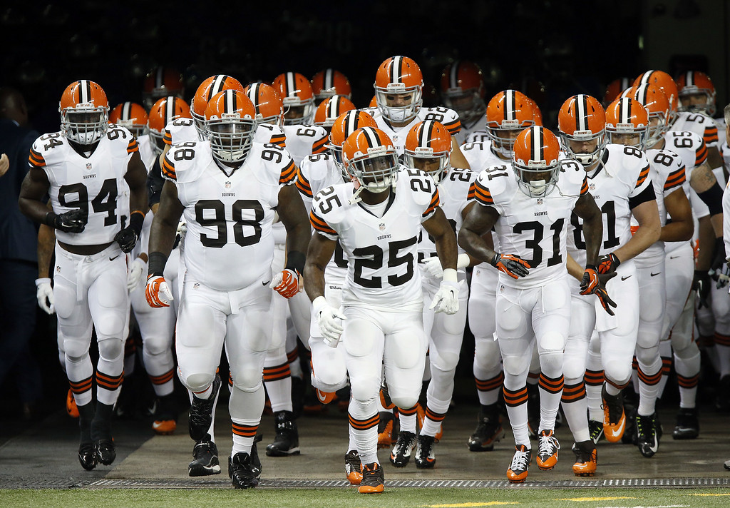 Description of . The Cleveland Browns take the field before the first half of a preseason NFL football game against the Detroit Lions at Ford Field in Detroit, Saturday, Aug. 9, 2014.  (AP Photo/Duane Burleson)