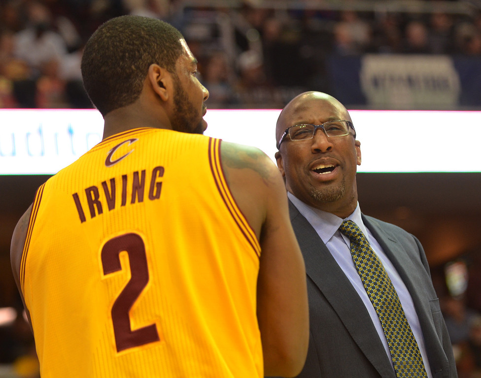 Description of . Michael Allen Blair/Digital First Media Cavs' guard Kyrie Irving talks things over with head coach Mike Brown after a foul call during the first quarter of Wednesday's game at Quicken Loans Arena. Big questions remain with Irving heading into the final year of his contract next season.