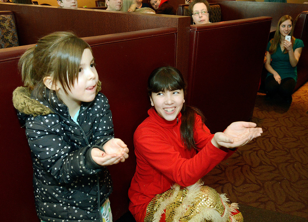 Description of . Maribeth Joeright/MJoeright@News-Herald.com Kyla Sue Hammond of Willoughby Hills, left,  and Allison Kwan of Cleveland hope the lion will toss them an orange during a traditional dance of the Chinese New Year being celebrated on Sundays during the month of February at Imperial Dragon in Mentor