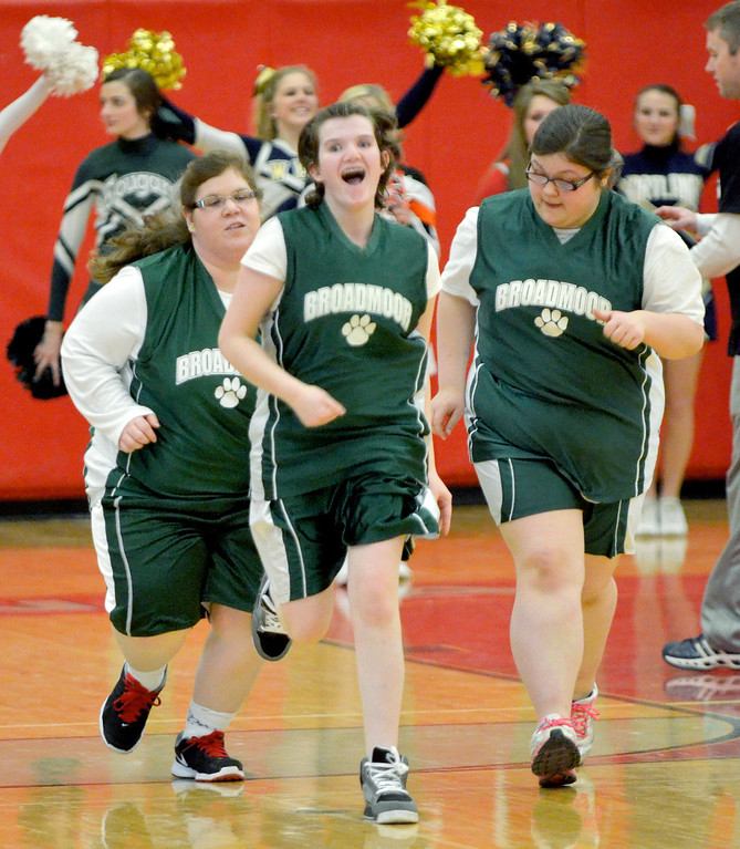 Description of . Jeff Forman/JForman@News-Herald.com  Mellisa Welch, center, celebrates her basket as she runs down court in during Broadmoor School's game against area high school coaches March 24 at Mentor High School.