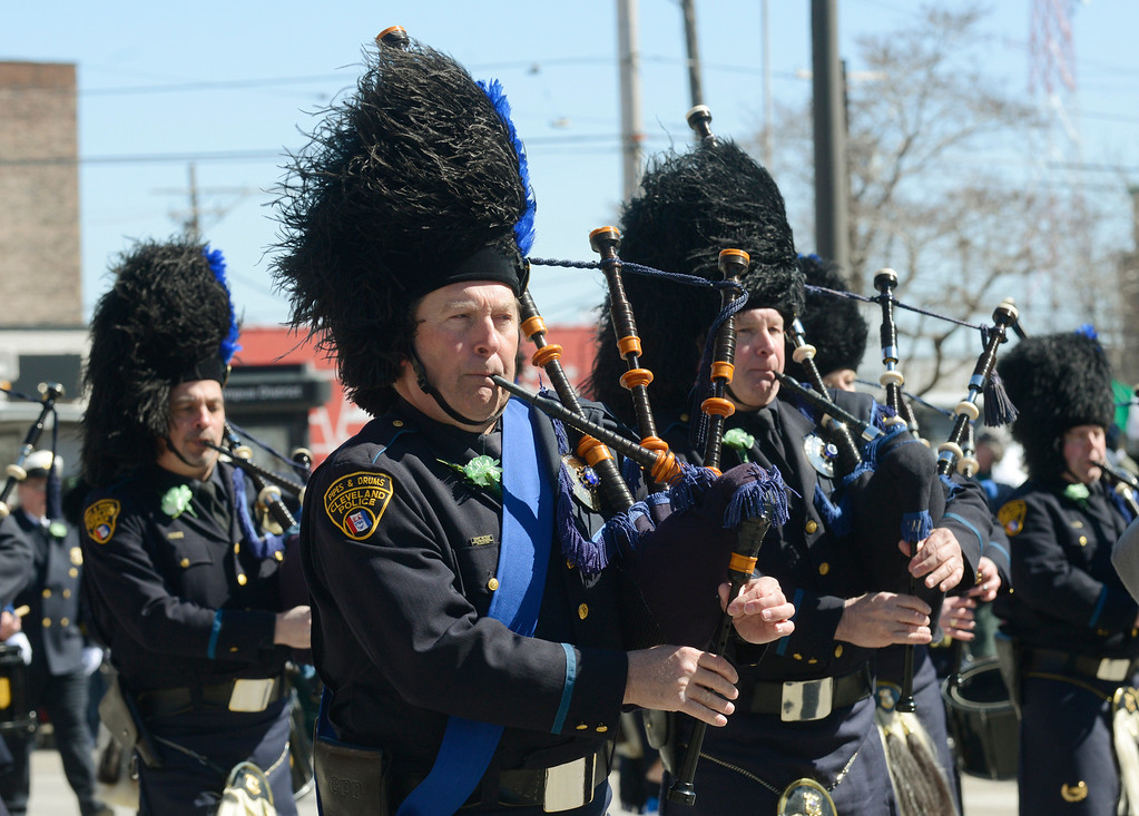 Description of . Maribeth Joeright/MJoeright@News-Herald.com<p> The Cleveland Police Pipe and Drum band take part in the 147th annual St. Patrick's Day Parade, March 17, 2014.