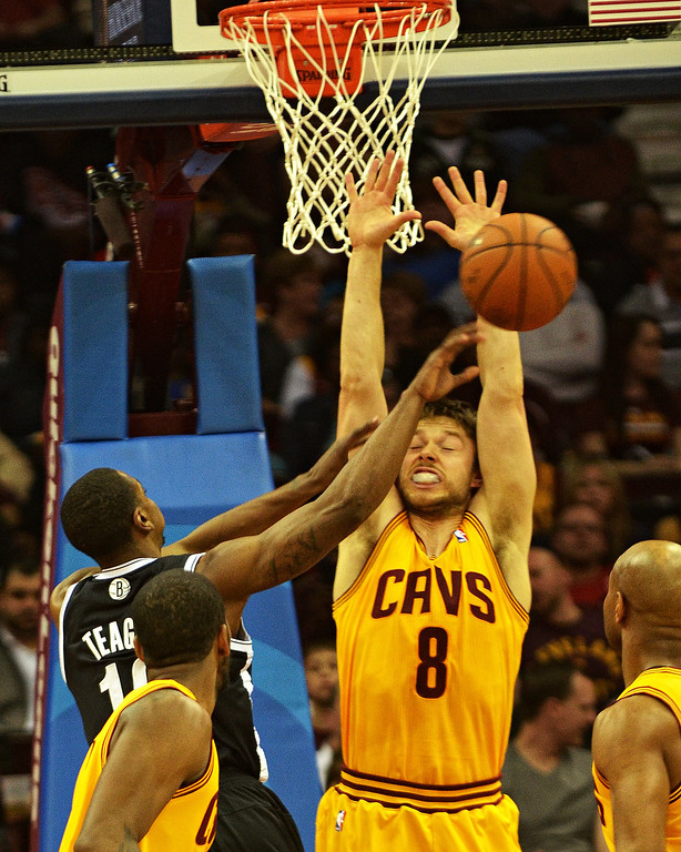 Description of . Michael Allen Blair/Digital First Media Cavs' guard Matthew Dellavedova defends the basket from the Nets' Marquis Teague during the second quarter of a game April 16 at Quicken Loans Arena.