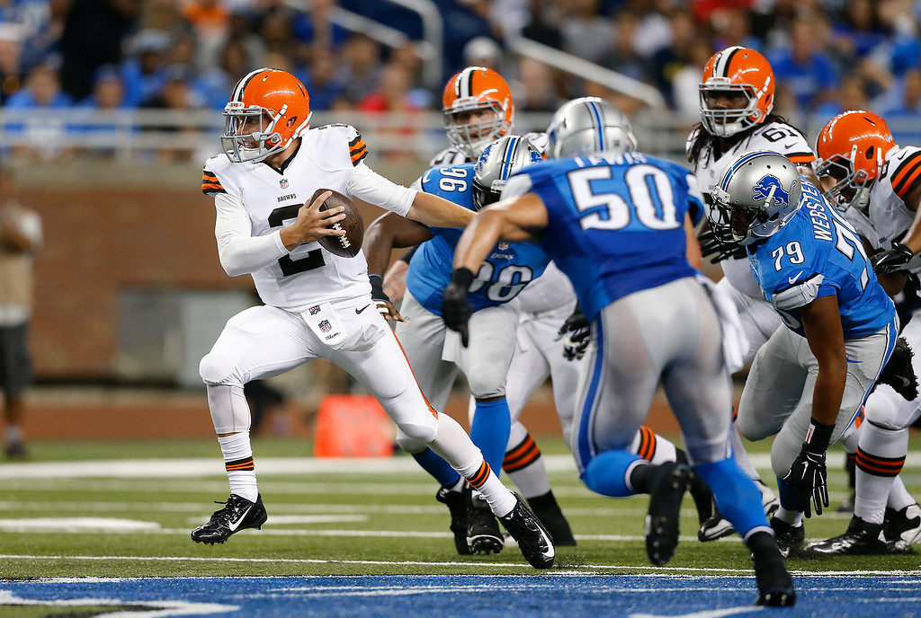 Description of . Cleveland Browns quarterback Johnny Manziel (2) scrambles from the Detroit Lions rush in the second half of a preseason NFL football game at Ford Field in Detroit, Saturday, Aug. 9, 2014. (AP Photo/Rick Osentoski)