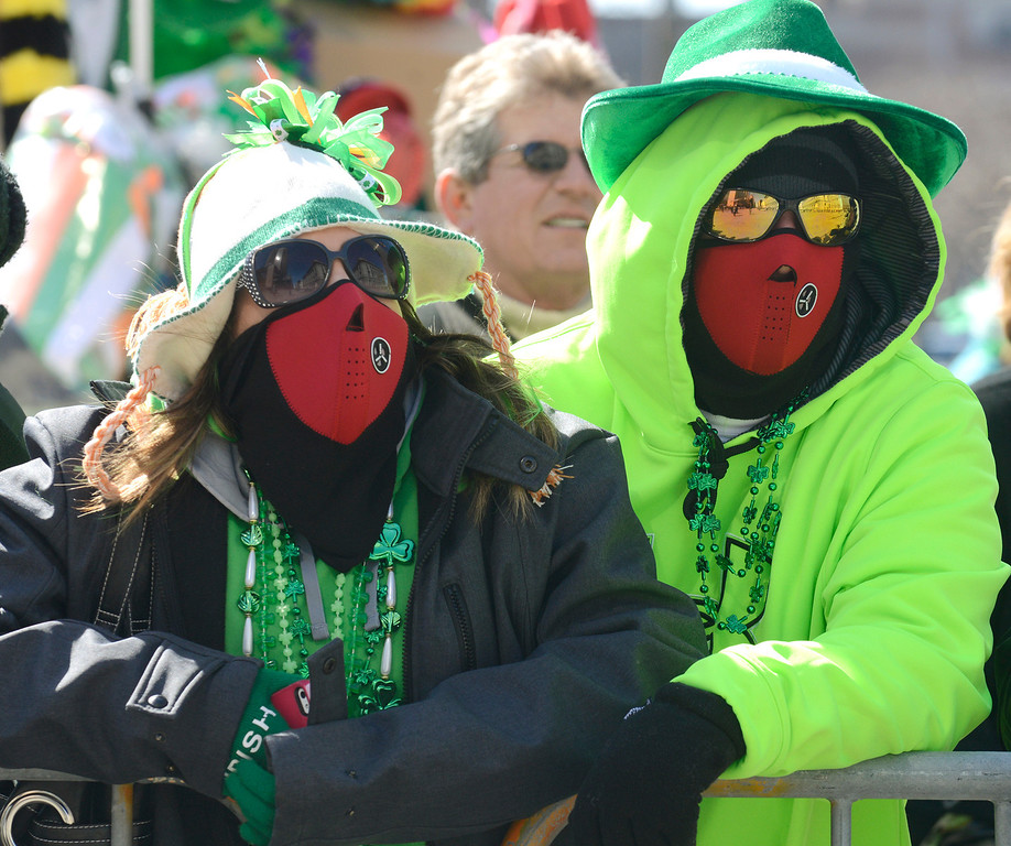 Description of . Maribeth Joeright/MJoeright@News-Herald.com<p> Holly and Joe Novak of Fairport Harbor pull out all the stops to stay warm as they watch the 147th annual St. Patrick's Day parade in Cleveland, March 17 2014.