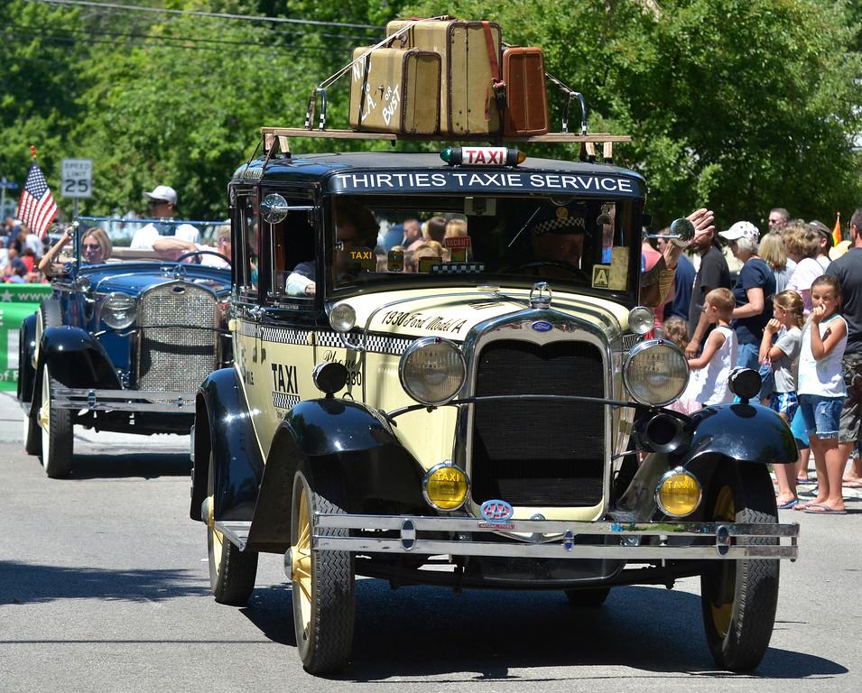 Description of . Jeff Forman/JForman@News-Herald.com Classic cars in the Mentor Headlands July 4th Parade.