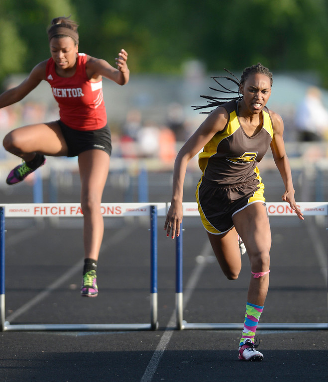 Description of . Maribeth Joeright/MJoeright@News-Herald.com<p> Brush's Asya Reynolds qualified for state in the girls 300 meter hurdles during the Division I regional final track meet, May 30, 2014. Also shown is Mentor's Aysha Muhammad.