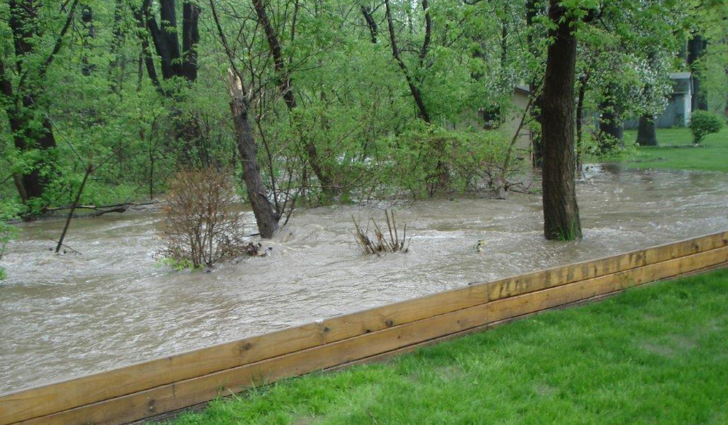 Description of . Floodwaters through the Martin's run area of Washington Avenue from the May 12, 2014 storms.
