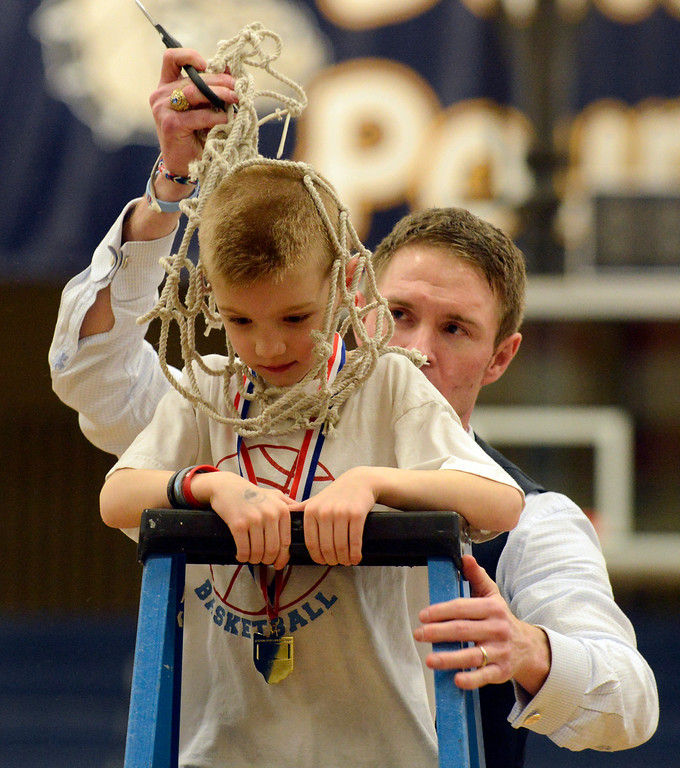 Description of . Maribeth Joeright/MJoeright@News-Herald.com  Villa Angela-St. Joseph coach Babe Kwasniak places the basketball net over his son, Quinn's head as they celebrated the team's 75-62 victory over Warrensville Height and clinching the Division III district chamionship, March 7, 2014.