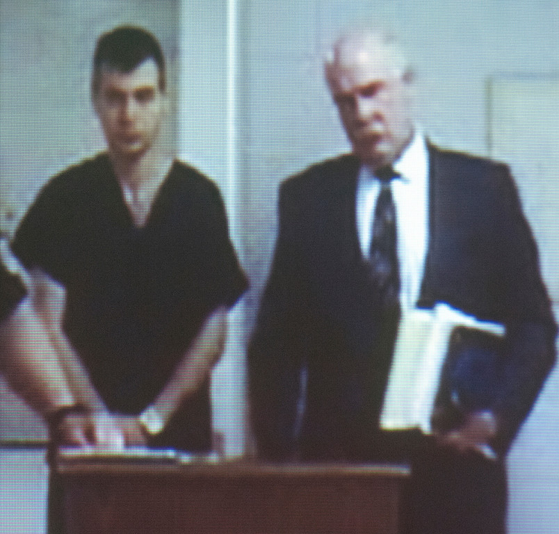 Description of . Duncan Scott/DScott@News-Herald.com Nathaniel Brown is arraigned via video on murder charges on April 20, 2011 in Willoughby Municipal Court in the death of William Andrew Fayne Putzbach. At right is Brown's lawyer John Luskin.