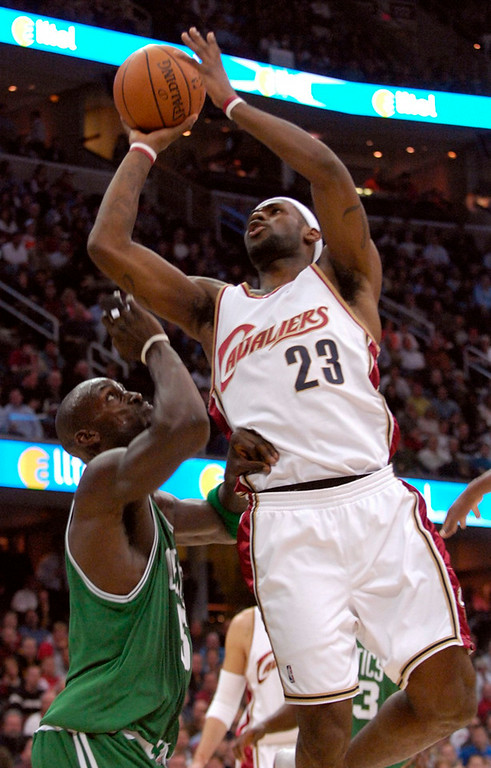 Description of . Cavaliers forward LeBron James goes up for a shot as Celtics forward Kevin Garnett is unable to block his shot during the first quarter Tuesday at Quicken Loans Arena.