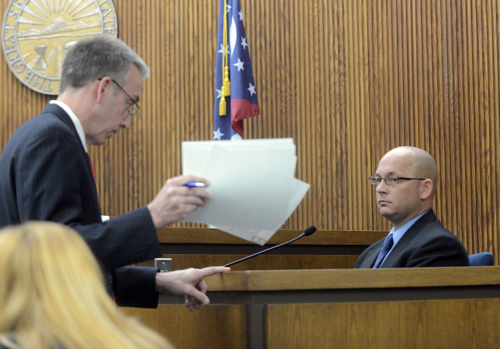 Description of . Duncan Scott/DScott@News-Herald.com Prosecutor John P. O'Donnell shows Willoughby Hills Det. Ron Parmertor photos during testimony in Lake County Common Pleas Court on June 9, 2014, day six of Kevin Knoefel's trial on a charge of conspiracy to commit aggravated murder.