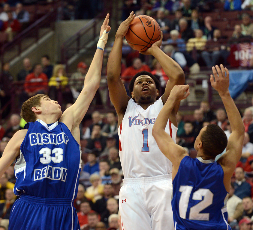 Description of . Duncan Scott/DScott@News-Herald.com VASJ's Brian Parker goes up for a shot in the first quarter defended by Columbus Bishop Ready's Josh Gantz, left, and Shane Lee. VASJ won the Division III state semifinal on March 21, 55-40, to advance to the state final on March 22.
