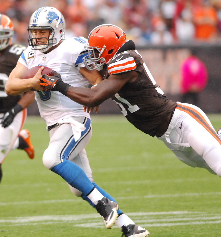 Description of . Michael Allen Blair/MBlair@21st-CenturyMedia.com Browns' linebacker Barkevious Mingo can't bring down the Lions' Matthew Stafford as he slips away for a gain during the second quarter versus the Lions at FirstEnergy Stadium in Cleveland, OH. on Sunday, October 13, 2013.