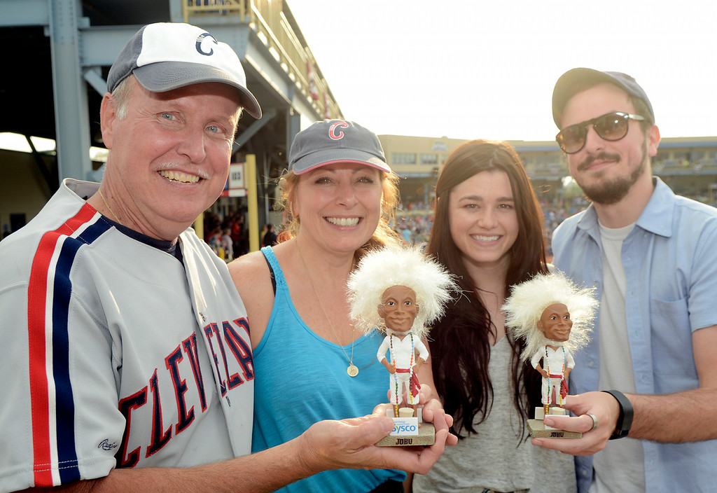 Description of . Duncan Scott/DScott@News-Herald.com Showing off their Jobu bobbleheads at Cleveland Sports History Night on August 1 and Classic Park are, from left, Chuck and Ankita Comella, Carly Bartel and Chris Comella. Chuck Comella was at Classic Park before 9 a.m. on August 1 to make certain he received one of the 1500 bobbleheads available.