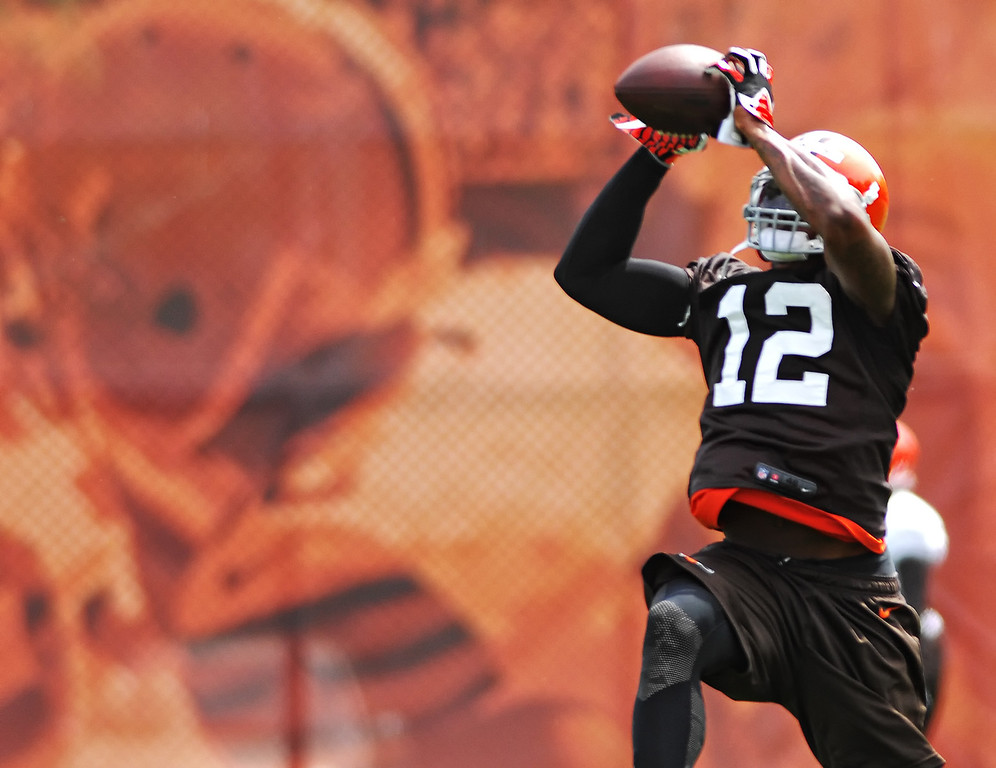 Description of . Michael Allen Blair/Digital First Media Browns' wide receiver Josh Gordon catches a pass during organized team activities on May 21 in Berea.