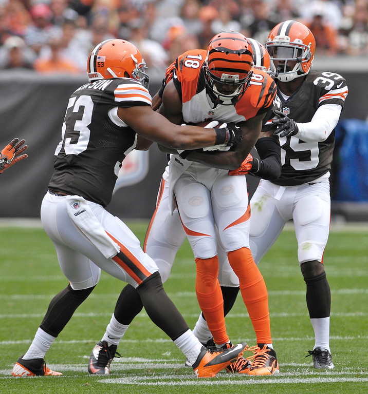 Description of . Jeff Forman/JForman@News-Herald.com Bengas wide receiver A.J. Green is wrapped up by Cleveland defenders Craig Robertson, left, and Tashaun Gipson during the first quarter of the Browns' 17-6  win over Cincinnati Sunday at FirstEnergy Stadium.