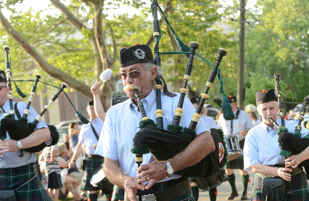 Description of . Maribeth Joeright/MJoeright@News-Herald.com<p> Members of the Geauga Highlanders Pipes and Drums take part in the annual Fairport Harbor Mardi Gras parade to kick off the July 4th holiday festivities.