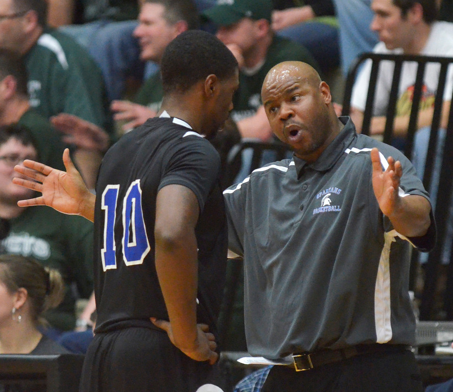 Description of . Jeff Forman/JForman@News-Herald.com Richmond Heights coach jason Priah talks with Dontez Lockett in the fourth quarterof the Spartans' 59-45 Division IV regional semifinal win over Malvern March 11 at the Canton Field House.