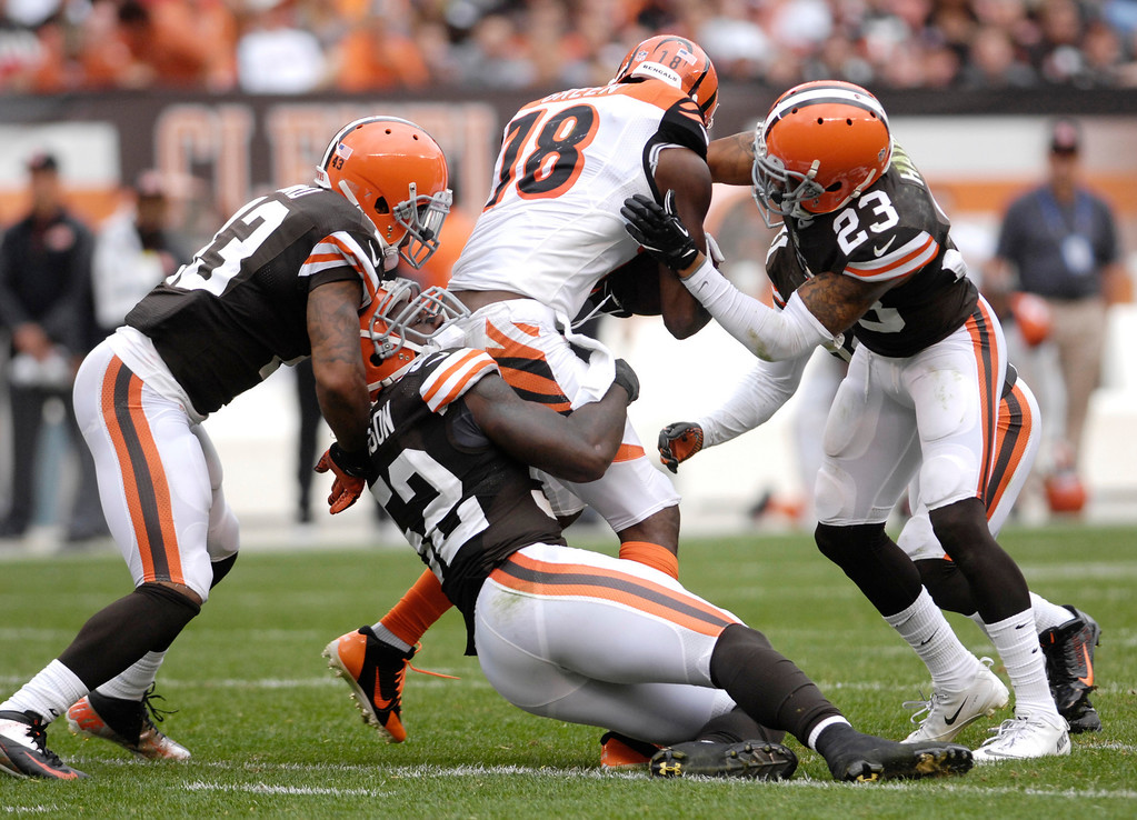 Description of . Jeff Forman/JForman@News-Herald.com Bengals wide receiver A.J. Green is wrapped up by Browns defenders Craig Robertson, left, D'Qwell Jackson and Joe Haden in the fourth quarter of the Browns' win Sunday at FirstEnergy Stadium.