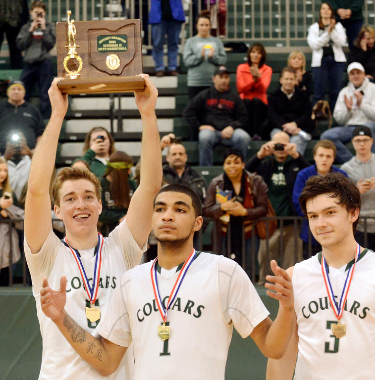 Description of . Maribeth Joeright/MJoeright@News-Herald.com<p> Lake Catholic's Ben Meola, from left, Zavier Powers and Brett Nalepa show off the team's Division II district championship trophy after defeating Chagrin Falls by a score of 68-59, March 8, 2014.