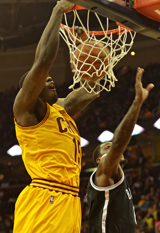 Description of . Michael Allen Blair/Digital First Media Cavs' forward Anthony Bennett dunk over Nets' defefender Andray Blatche during the first quarter of Wednesday's game at Quicken Loans Arena. Big questions remain with Bennett heading into his second year after being selected number one overall in last year's NBA draft.