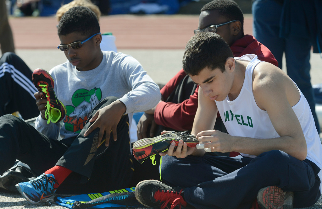 Description of . Maribeth Joeright/MJoeright@News-Herald.com<p> Mayfield's Washawn Collins, left, and Anthony Gamerman clean their cleats as they prepare for their upcoming events at the Hilltopper Invitational track meet. Collins was preparing for the 110 meter hurdles and Gamerman for the pole vault.