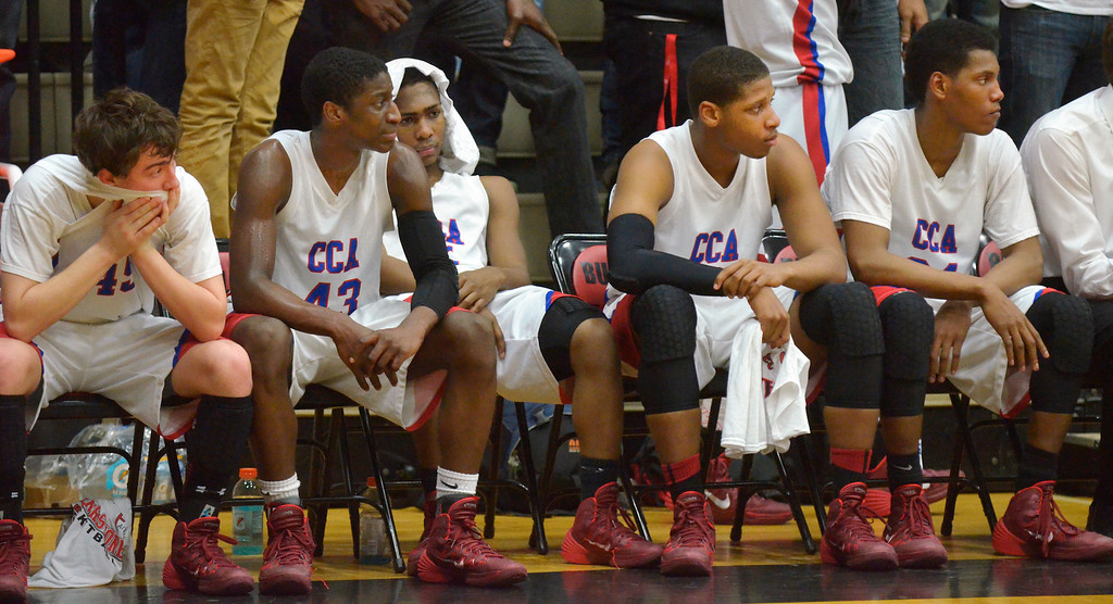 Description of . Jeff Forman/JForman@News-Herald.com Jeff Forman/JForman@News-Herald.com Cornerstone Christian players R.J. Spaller, left, Bryan Gee Gregory Oliver, Julian Gee, and Tyrez Shephard  watch as their season ends March 11 with a 58-37 Division IV Regional semifinal loss to St. Thomas Aquinas at the Canton Field House. .