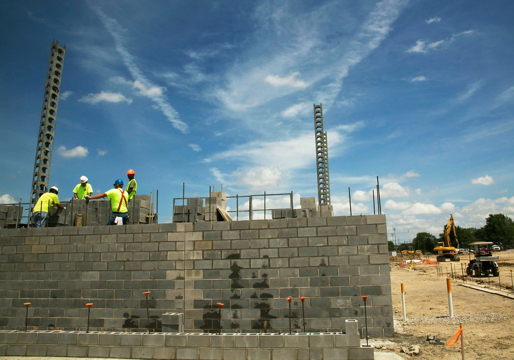 Description of . Michael Allen Blair/MBlair@MorningJournal.com Brick layers assemble a wall of what will be the gymnasium of the new Lorain Admiral King High School in Lorain on June 30.
