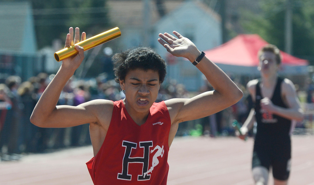 Description of . Maribeth Joeright/MJoeright@News-Herald.com<p> Harvey anchor Deondre Martin reacts as he crosses the finish line, helping his team to victory in the boys 4X800 meter relay during the Hilltopper Invitational track meet at Chardon High School.