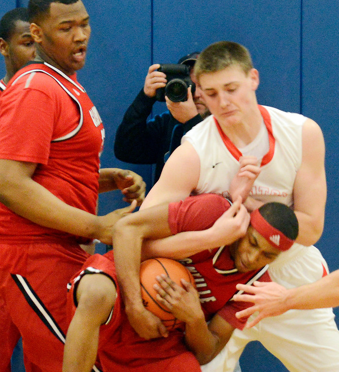 Description of . Maribeth Joeright/MJoeright@News-Herald.com<p> Mentor's Micah Potter and Glenville's DrayVon Hutchinson battle for the rebound during the first quarter of the Division 1 district semifinal game, March 6, 2014.