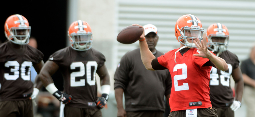 Description of . Maribeth Joeright/MJoeright@News-Herald.com <p> Browns quarterback Johnny Manziel throws  during the first day of mini camp in Berea, June 10, 2014.