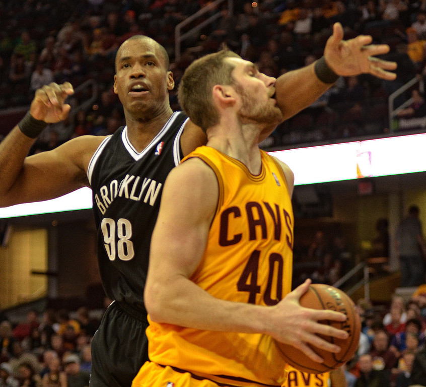 Description of . Michael Allen Blair/Digital First Media Cavs' center Tyler Zeller gets a stiff arm from the Nets Jason Collins during the fourth quarter of a game April 16 at Quicken Loans Arena.