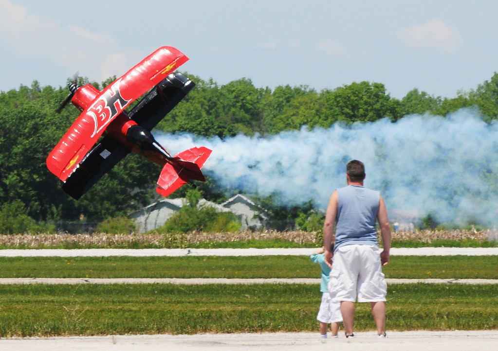 Description of . Jim Bobel/JBobel@MorningJournal.com Brent Hunter opens up the Discover Aviation  Air Show at the Lorain County Regional Airport. Hunter flow his plane side ways down the runway.