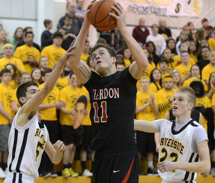 Description of . Duncan Scott/DScott@News-Herald.com Chardon's Joe Fodor goes up for a shot in the second quarter defended by Riverside's Brad Rinella, left, and Austin Hess. Riverside won Friday's PAC matchup 49-43 at the Riverside Community Field House.