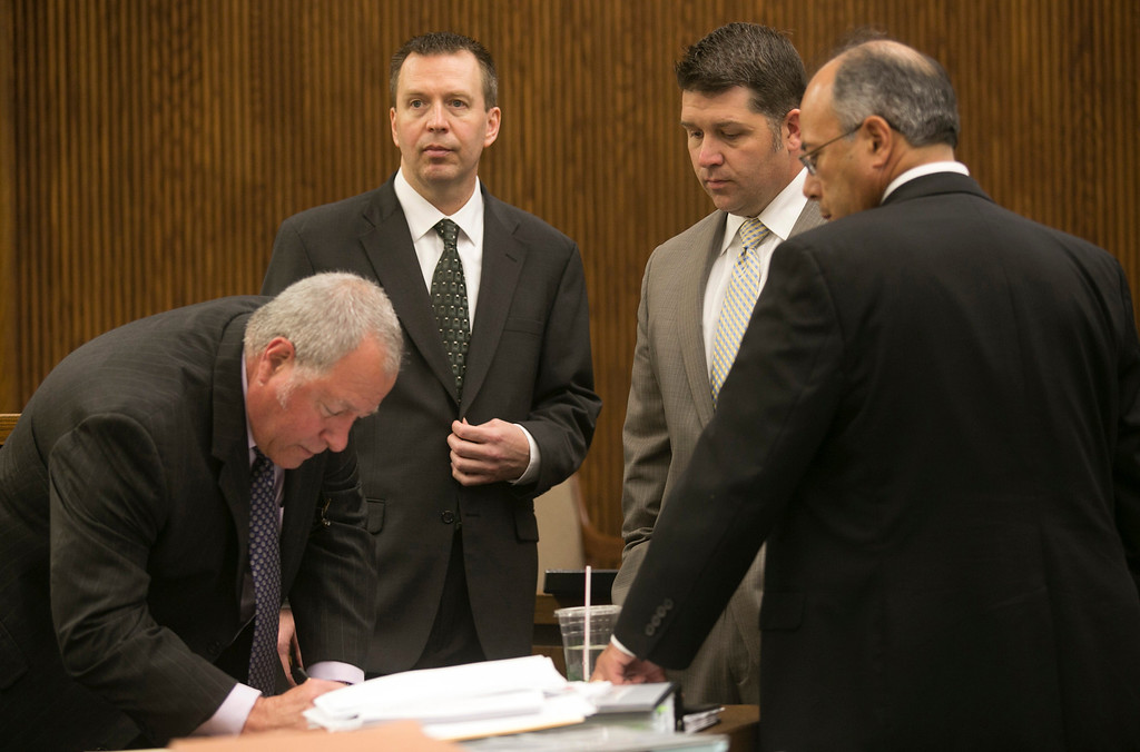 Description of . Michael Allen Blair/MBlair@News-Herald.com Kevin Knoefel, second from left and his defese team from left; Michael J. Connick, Gary Vick Jr. and Dennis N. LoConti prepare to cross examine Knoefel's good friend David Strunk during Knoefel's murder conspiracy trial in Lake County Common Pleas Court on  June 4, 2014.