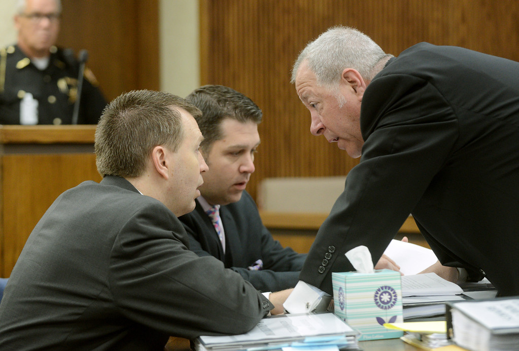 Description of . Duncan Scott/DScott@News-Herald.com Kevin Knoefel, left, meets with his defense team including Gary Vick Jr., center, and Michael J. Connick, in Lake County Common Pleas Court on June 9, 2014, day six of Knoefel's trial on a charge of conspiracy to commit aggravated murder.