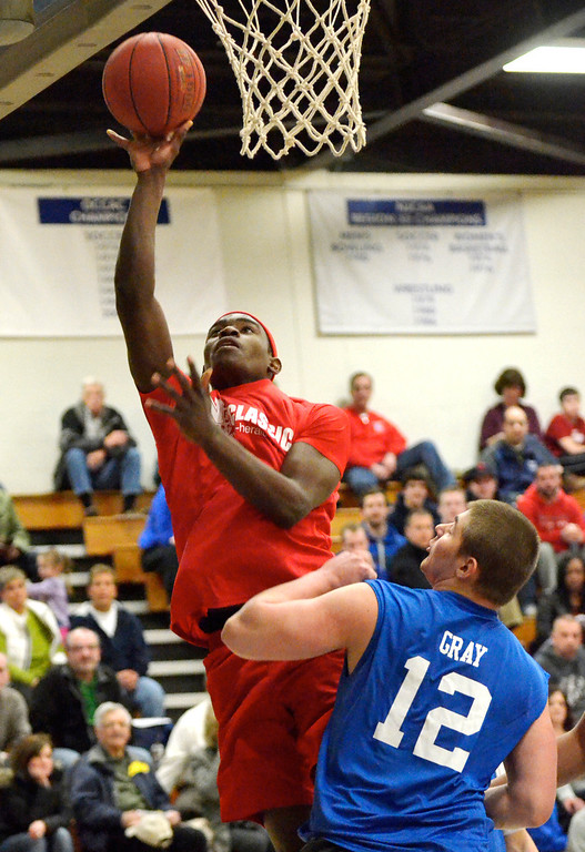 Description of . Jeff Forman/JForman@News-Herald.com Deandre Forte, Red Team, shoots over Andrew Gray during the 36th News-Herald Classic March 29 at Lakeland Community College.