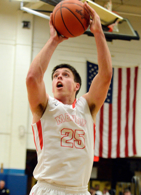 Description of . Maribeth Joeright/MJoeright@News-Herald.com Mento's Caleb Potter shoots and scores during the Division I district semifinal game against Glenville, March 6, 2014.