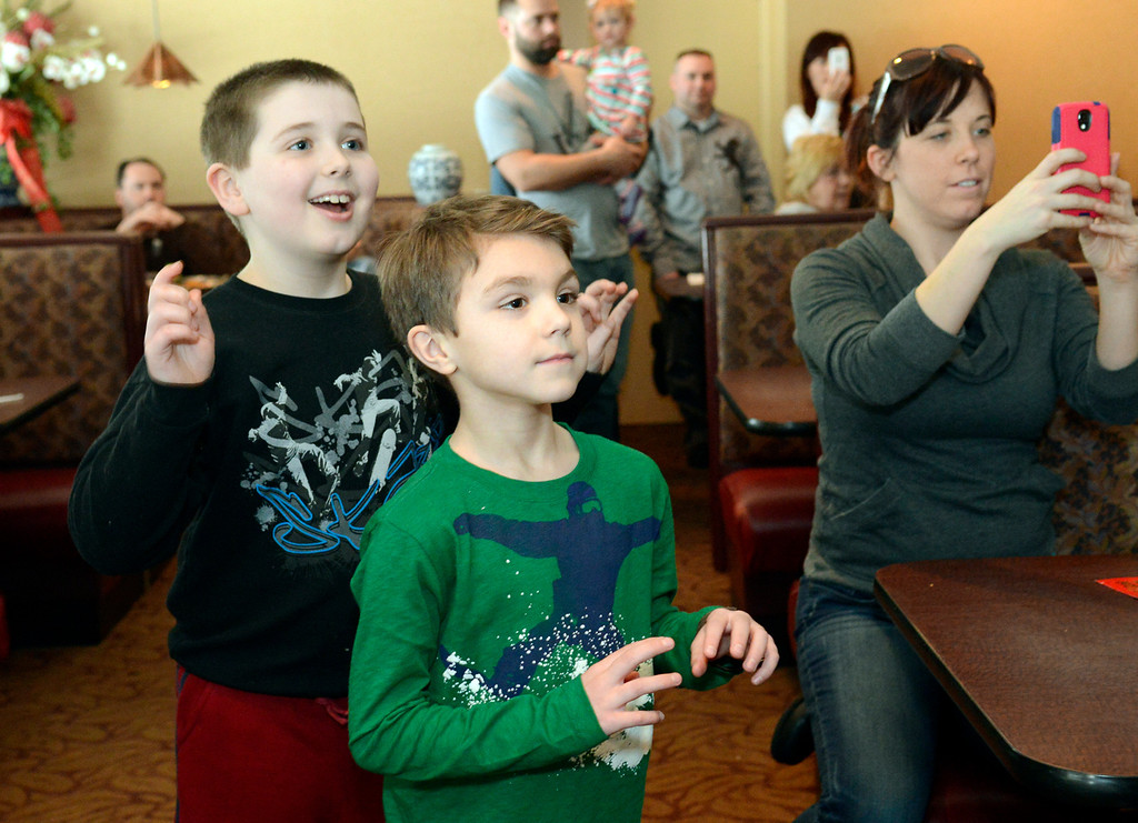Description of . Maribeth Joeright/MJoeright@News-Herald.com Julian Dugan, 7, of Rocky River, left, Tyler Davis, 7 of Mentor and Rebecca Hammond of Willoughby Hills along with other diners at Imperial Dragon in Mentor, were a captive audience during the traditional lion dance to celebrate the Chinese New Year, Sunday.