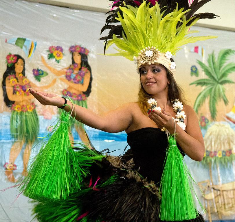Description of . Duncan Scott/DScott@News-Herald.com Jessica Wiener of Ohana Aloha perfroms a hula dance during a luau at the Lake County Board of Developmental Disabilities/Deepwood Vocational Guidance Center.