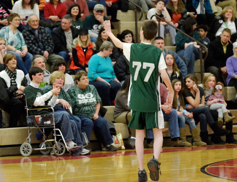 Description of . Jeff Forman/JForman@News-Herald.com  Bobcat Steven Petrogach waves to the crowd during Broadmoor School's game against area high school coaches March 24 at Mentor High School.
