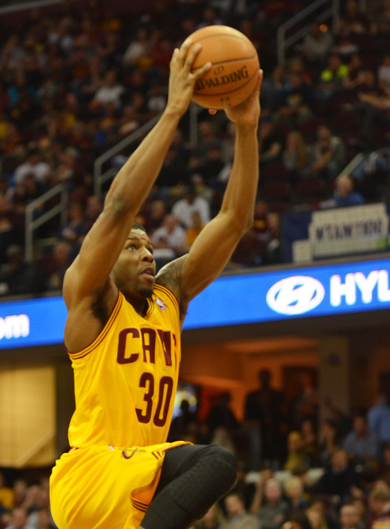 Description of . Michael Allen Blair/Digital First Media Cavs' forward Carrick Felix goes up for a dunk during the fourth quarter of a game April 16 at Quicken Loans Arena.