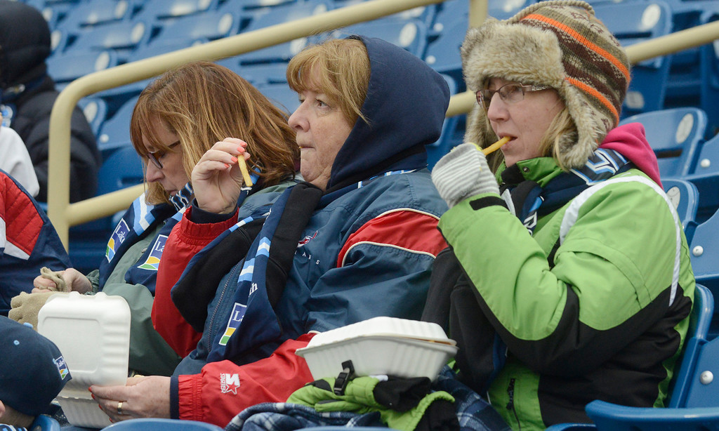 Description of . Maribeth Joeright/MJoeright@News-Herald.com<p> Karen Masarik of North Olmsted, from left, Cindy Jastromb, of Fairport Harbor and Amy Brunkus of Mayfield Heights snack on ballpark food while taking in the opening ceremonies of the Lake County Captains home opener at Classic Park.