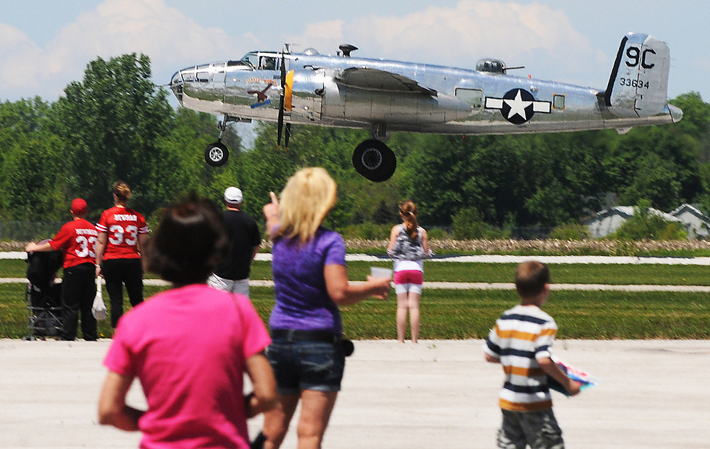 Description of . Jim Bobel/JBobel@MorningJournal.com The B-25 World War II Bomber Yankee Warrior takes off at the Discover Aviation Air Show at the Lorain County Regional Airport.