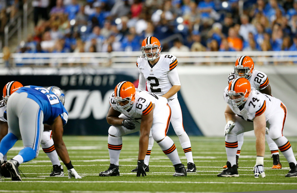Description of . Cleveland Browns quarterback Johnny Manziel (2) lines up against the Detroit Lions in the first half of a preseason NFL football game at Ford Field in Detroit, Saturday, Aug. 9, 2014.  (AP Photo/Rick Osentoski)