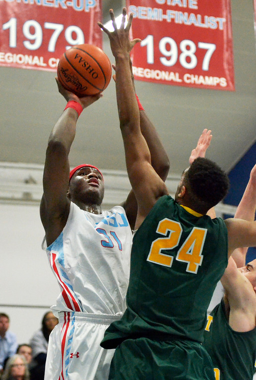Description of . Jeff Forman/JForman@News-Herald.com Carlton Bragg, VASJ, shoots as Malik Smith, St. Edward, defends in the second quarter of the Vikings' 82-76 loss Feb. 20 at Villa Angela -St. Joseph High School.