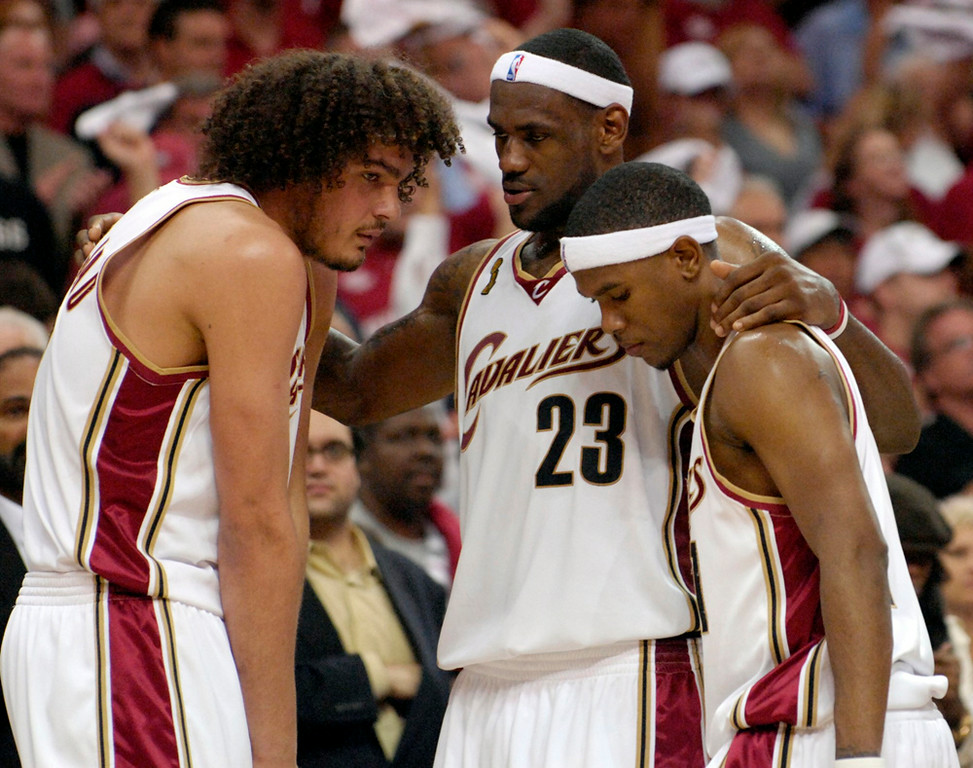 Description of . Lebron James tries to pump his his teammates Anderson Varejao and Daniel Gibson in the fourth quarter of Game 4 of the NBA finals against the Spurs.