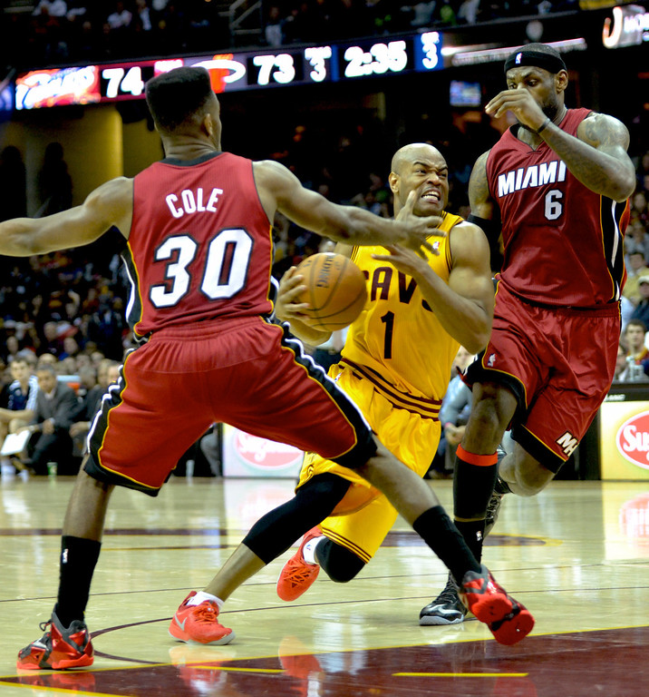 Description of . Jeff Forman/JForman@News-Herald.com Jarrett Jack drives to the basket between Norris Cole and LeBron James in the fourth quarter of the Cavaliers' 100-96 loss to the Heat March 18 at Quicken Loans Arena.