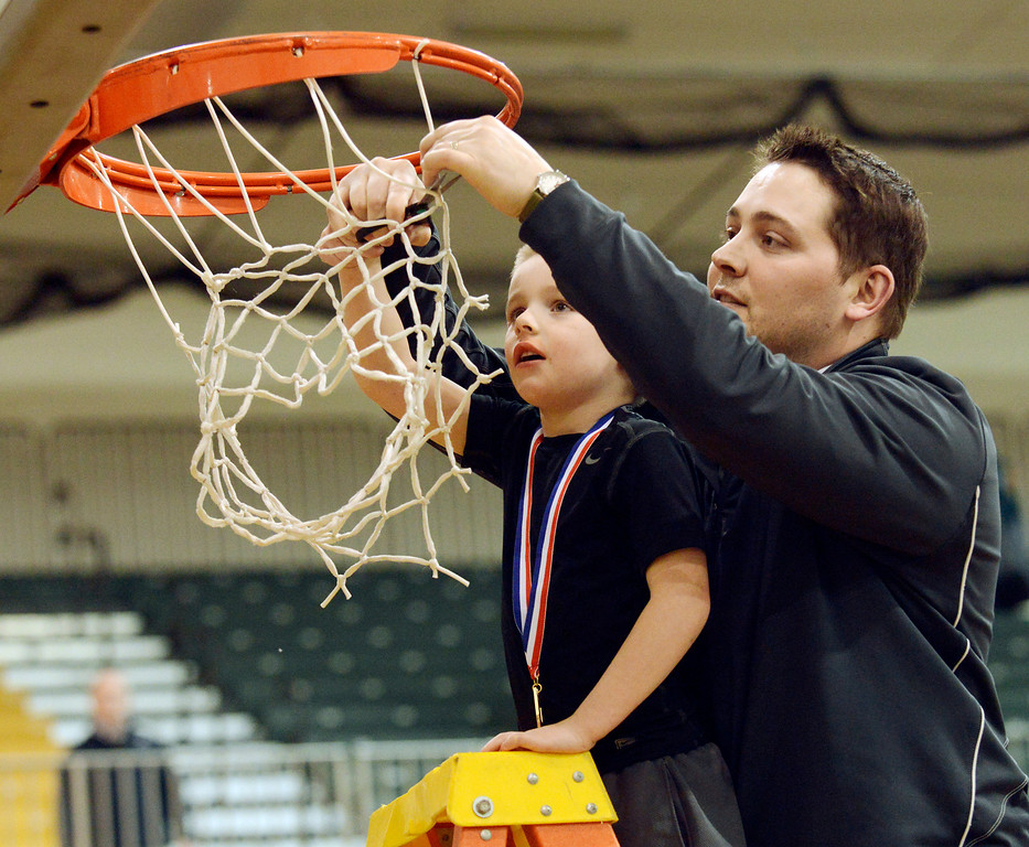 Description of . Maribeth Joeright/MJoeright@News-Herald.com<p> Lake Catholic assistant coach Matt Moran and his son Brady cut the net after the team won the Divison II district chamionship, beating Chagrin Falls 68-59, March 8, 2014.